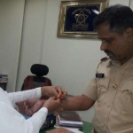 BK Dolly tying Rakhi to Shri. Shantanu Pawar, Head of Santacruz Police Station