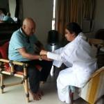 BK Vinita tying Rakhi to Actor Prem Chopra ji